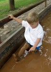 Grayson loved the muddy water