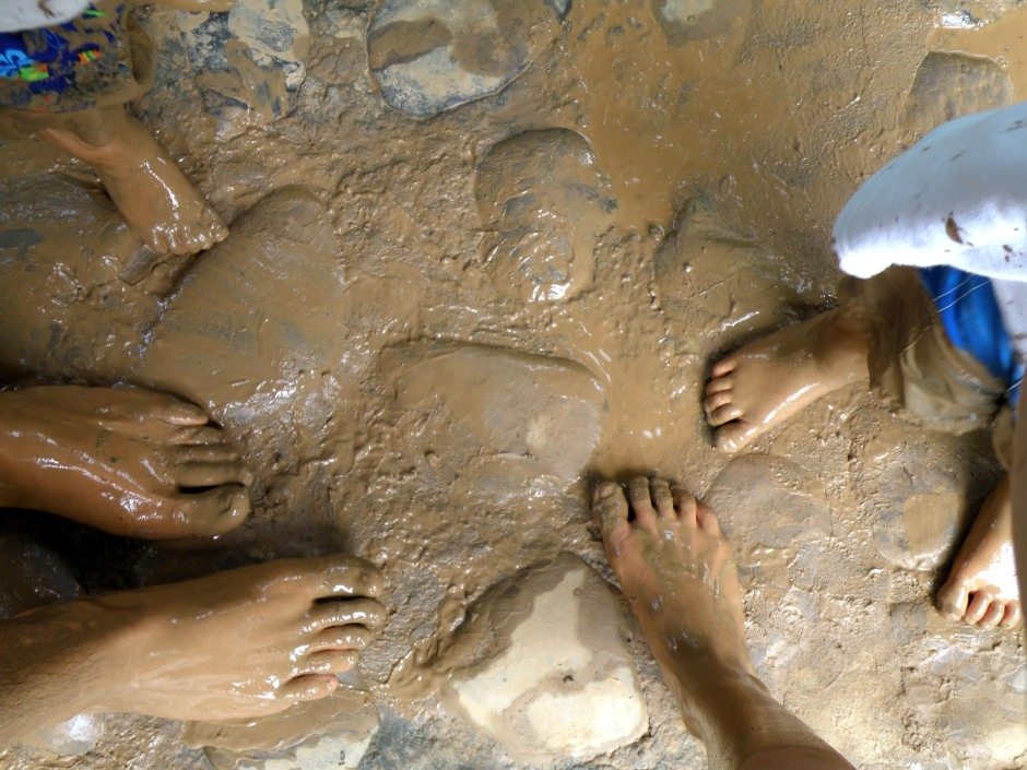 A family of muddy feet