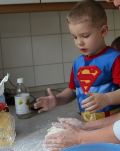 showing kids how to knead dough